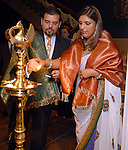 Pershant and Nidhika Mehta light a candle during a ceremony at the Arts of India Gallery launch party at the Museum of Fine Arts Houston Thursday May 14,2009.(Dave Rossman/For the Chronicle)