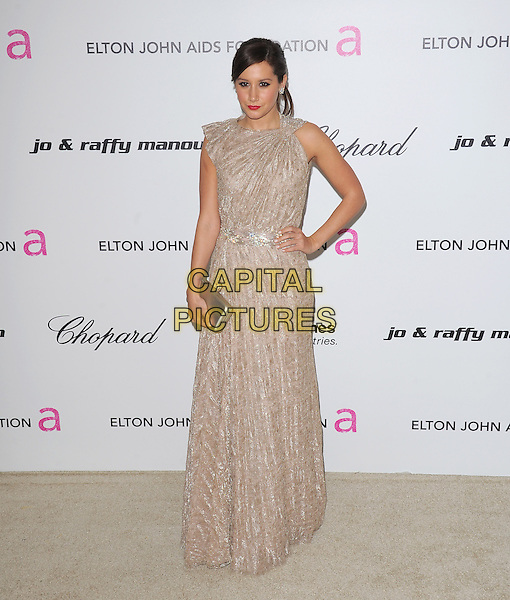 ASHLEY TISDALE  .19th Annual Elton John AIDS Foundation Academy Awards Viewing Party held at The Pacific Design Center, West Hollywood, California, USA..February 27th, 2011.full length dress clutch bag silver gold beige maxi hand on hip.CAP/RKE/DVS.©DVS/RockinExposures/Capital Pictures.