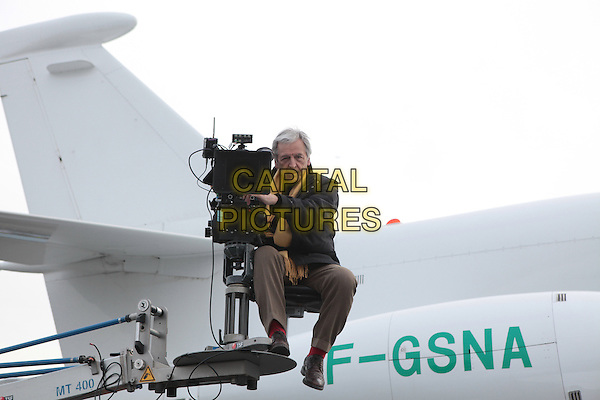Costa-Gavras (Director)<br /> on the set of Capital (2012) <br /> *Filmstill - Editorial Use Only*<br /> CAP/FB<br /> Image supplied by Capital Pictures