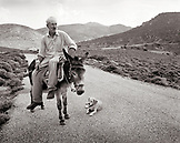 GREECE, Patmos, portrait of Shepard Stephanos riding his donkey Alekos from the sea to his animals inland (B&W)