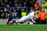 Danny Cipriani of England dives over to score a try moments after coming onto the pitch as a substitute during the RBS 6 Nations match between England and Italy at Twickenham Stadium on Saturday 14th February 2015 (Photo by Rob Munro)