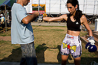 Shuki (L) ties Lital's (R) Boxing gloves just before her Muay Thai fight in Phigit..(please refer to emailed captions for individual stories)..Shuki Rosenweig brings five fighters to fight in Phigit, a town 3 hours north of Bangkok, on 1st February 2010. Lital, Ilya, Gil and two other fighters, one from France and another from Brazil..Photo by Suzanne Lee for Chabad Lubavitch