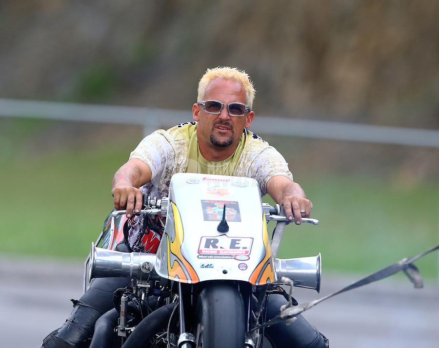 Jun 20, 2015; Bristol, TN, USA; NHRA top fuel harley motorcycle rider XXXX during qualifying for the Thunder Valley Nationals at Bristol Dragway. Mandatory Credit: Mark J. Rebilas-