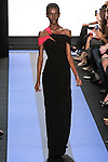 Kerieth walks runway in a carbon black jersey off the shoulder draped asymmetric gown with magenta accent, by Monique Lhuillier, from the Monique Lhuillier Spring 2012 collection fashion show, during Mercedes-Benz Fashion Week Spring 2012.