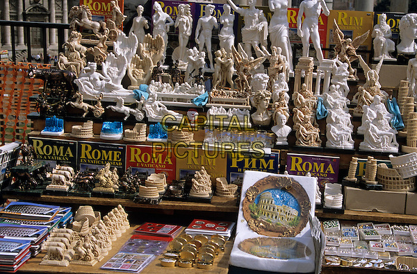 Rome guide books and souvenirs on display on a stall, Rome, Italy