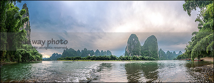 A peaceful summer morning in Lijiang River, China, with the famous limestone formations.