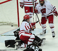 Badger senior, Meghan Duggan, scores, as junior, Hilary Knight (23) looks on, as the University of Wisconsin women's hockey team tops North Dakota 8-4 on Sunday, 2/13/11, at the Kohl Center in Madison, Wisconsin