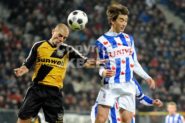 HEERENVEEN - Voetbal, SC Heerenveen - NAC , Eredivisie,  Abe Lenstra stadion, seizoen 2011-2012, 17-02-2012 kopdiel NAC Breda speler Anthony Lurling (l) met SC Heerenveen speler Filip Djuricic (r).