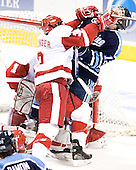 Matt Olinger, Keith Johnson - The University of Wisconsin Badgers defeated the University of Maine Black Bears 5-2 in their 2006 Frozen Four Semi-Final meeting on Thursday, April 6, 2006, at the Bradley Center in Milwaukee, Wisconsin.  Wisconsin would go on to win the Title on April 8, 2006.
