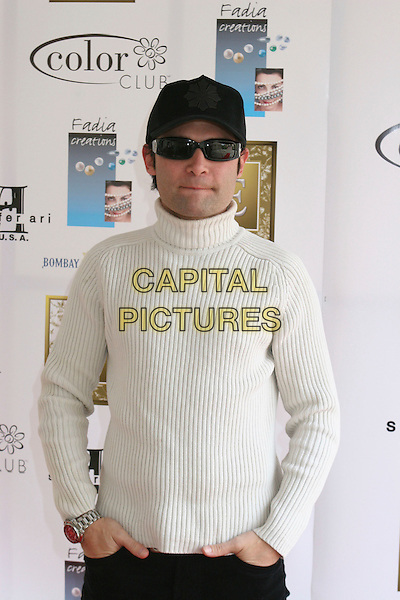 COREY FELDMAN.2nd Annual Make the Discovery Oscar Retreat,  West Hollywood, California, USA..March 3rd, 2006.Photo: Byron Purvis/AdMedia/Capital Pictures.Ref: BP/ADM.half length baseball cap hat white ribbed poloneck sunglasses shades.www.capitalpictures.com.sales@capitalpictures.com.© Capital Pictures.
