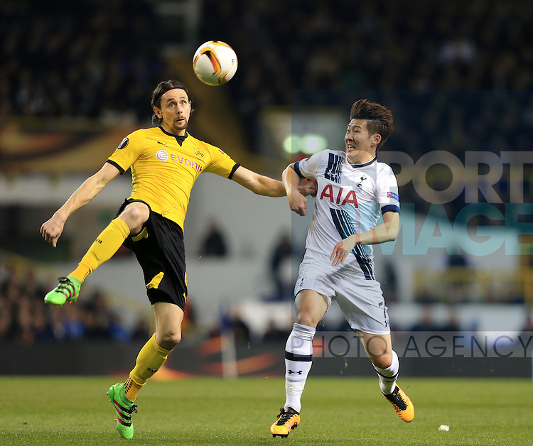 Tottenham's Son Heung-Min tussles with Dortmund's Neven Subotic during the Europa League match at White Hart Lane Stadium.  Photo credit should read: David Klein/Sportimage
