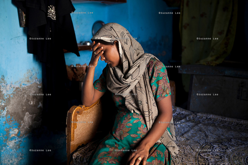 Shanno, 24, is 9 months pregnant with her 4th child as she sits on the bed in her rented one-room house in a slum in Tonk, Rajasthan, India, on 20th June 2012. Shanno was married at the age of 17 and has had 4 successive pregnancies which affected her health and her children's health because she was unable to breastfeed them and was too poor to raise them properly. She had also given one of her sons to her sister at birth. Her husband refuses to use contraceptives and she is not allowed to have an operation. Photo by Suzanne Lee for Save The Children UK