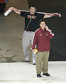 Boston College defenseman Brett Motherwell and student manager Justin Murphy check out the Kohl Center ice prior to warmups. The Boston College Eagles defeated the University of Wisconsin Badgers 3-0 on Friday, October 27, 2006, at the Kohl Center in Madison, Wisconsin in their first meeting since the 2006 Frozen Four Final which Wisconsin won 2-1 to take the national championship.<br />