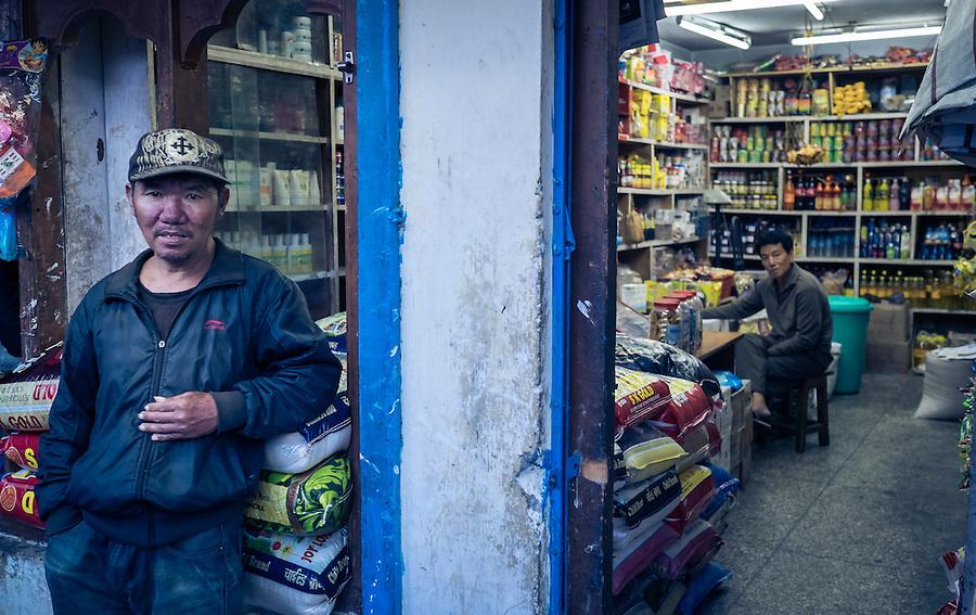 THIMPHU, BHUTAN - CIRCA OCTOBER 2014: Bhutanese man standing outside a general store in Thimpu, Bhutan