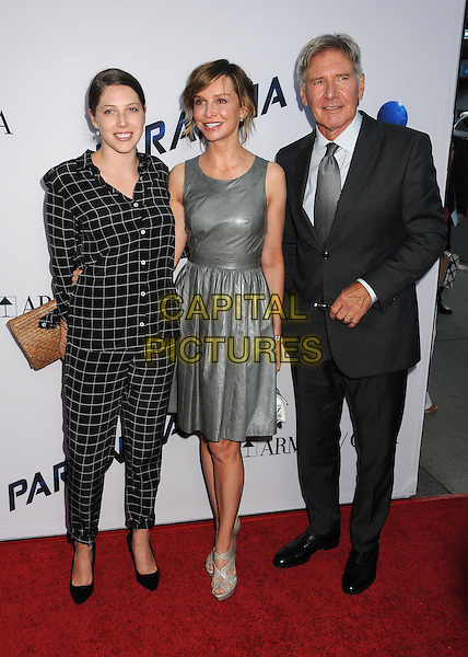Georgia Ford, Calista Flockhart, Harrison Ford<br /> &quot;Paranoia&quot; Los Angeles Premiere held at the Directors Guild of America, West Hollywood, California, USA, 8th August 2013.<br /> full length silver grey gray leather dress suit black checked plaid tie couple husband wife family trousers matching <br /> CAP/ADM/BP<br /> &copy;Byron Purvis/AdMedia/Capital Pictures