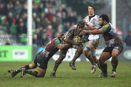 18.02.2011 Wame Lewaravu in possession for Sale being brought down Aviva Premiership Rugby from the Stoop. Harlequins v Sale Sharks.