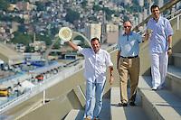 RIO DE JANEIRO, RJ, 12 DE FEVEREIRO DE 2012 - CARNAVAL RIO 2012 - O Prefeito Eduardo Paes (E), o presidente do Comitê Organizador dos Jogos Olímpicos, Carlos Arthur Nuzman, e o presidente da LIESA, Jorge Castanheira (D), na abertura oficial do novo Sambódromo do Rio, que também será utilizado nos Jogos Olímpicos, e que após reformas recebeu o traçado original projetado por Oscar Niemeyer há quase 30 anos. <br /> FOTO GLAICON EMRICH - NEWS FREE
