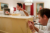 Washington, DC - November 30, 2009 -- Pastry chefs Jack Revelle, right, and Chris Phillips help construct a replica of the White House, made of gingerbread and white chocolate, in the China Room of the White House, Monday, November 30, 2009. .Mandatory Credit: Samantha Appleton - White House via CNP