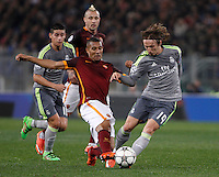 Calcio, andata degli ottavi di finale di Champions League: Roma vs Real Madrid. Roma, stadio Olimpico, 17 febbraio 2016.<br /> Roma's William Vainqueur, left, and Real Madrid's Luka Modric fight for the ball during the first leg round of 16 Champions League football match between Roma and Real Madrid, at Rome's Olympic stadium, 17 February 2016.<br /> UPDATE IMAGES PRESS/Isabella Bonotto