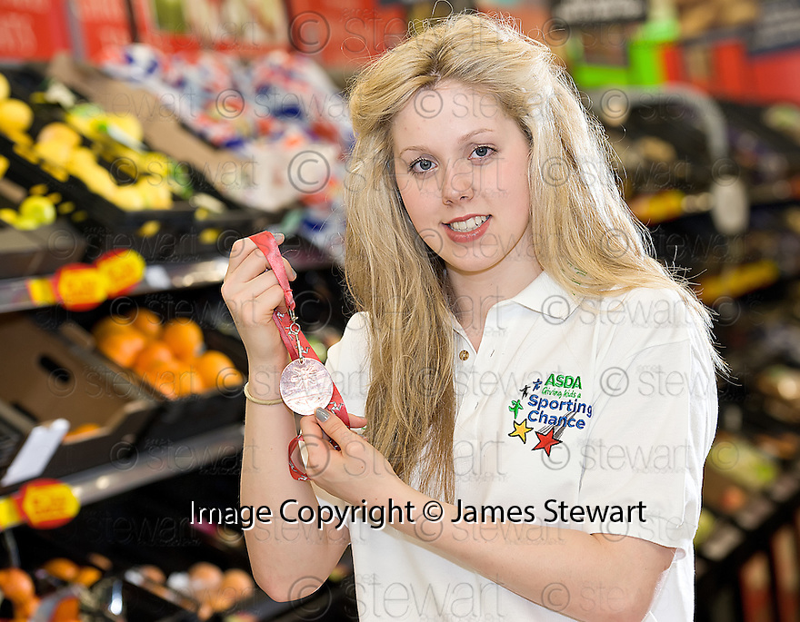 ASDA Stenhousemuir Athlete Sponsorship :<br /> <br /> Swimmer Charlotte McKenzie visits the ASDA store in Stenhousemuir to show off her Bronze 50m Backstroke Medal that she won at the Youth Commonwealth Games 2011 in the Isle of Man.