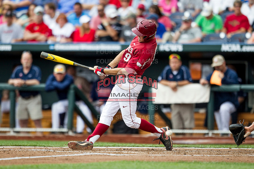 Arkansas Razorbacks first baseman Clark Eagan (9) swings the bat against the Virginia Cavaliers in Game 1 of the NCAA College World Series on June 13, 2015 at TD Ameritrade Park in Omaha, Nebraska. Virginia defeated Arkansas 5-3. (Andrew Woolley/Four Seam Images)