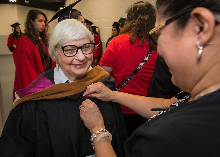 Bertie Simmons gets ready before the Furr / Reach High School graduation in Delmar Fieldhouse, May 26, 2017. The ceremony was the first graduation to be held in the newly constructed facility.