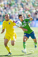 Seattle Sounders FC forward Fredy Montero (17) and Columbus Crew defender Rich Balchan (2) fight for the ball at CenturyLink Field in Seattle, Washington. The Sounders defeated Columbus Crew, 6-2.
