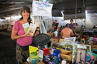 A local vendor holds Dragon Dust products at the Hilo Farmers Market, Big Island of Hawai'i.