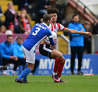 Lincoln City's Lee Angol vies for possession with Macclesfield Town's David Fitzpatrick<br /> <br /> Photographer Chris Vaughan/CameraSport<br /> <br /> Vanarama National League - Lincoln City v Macclesfield Town - Saturday 22nd April 2017 - Sincil Bank - Lincoln<br /> <br /> World Copyright &copy; 2017 CameraSport. All rights reserved. 43 Linden Ave. Countesthorpe. Leicester. England. LE8 5PG - Tel: +44 (0) 116 277 4147 - admin@camerasport.com - www.camerasport.com