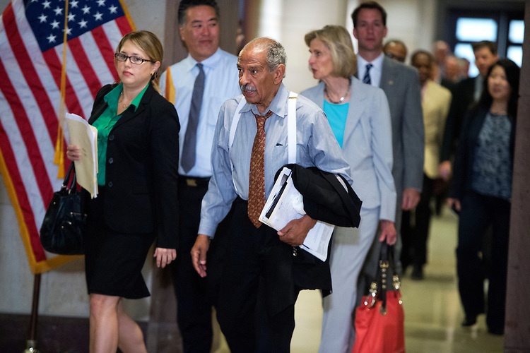 UNITED STATES - JULY 31: Rep. John Conyers, D-Mich., makes his way to a meeting in the Capitol Visitor Center with the House Democratic Caucus and President Barack Obama. (Photo By Tom Williams/CQ Roll Call)