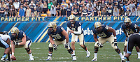 Pitt offense lines up. Shown are center Artie Rowell (57), quarterback Tom Savage (7), guard Ryan Schlieper (76), tackle Dorian Johnson (53) and running back Isaac Bennett (34). The North Carolina Tar Heels defeated the Pitt Panthers 34-27 at Heinz Field, Pittsburgh Pennsylvania on November 16, 2013.