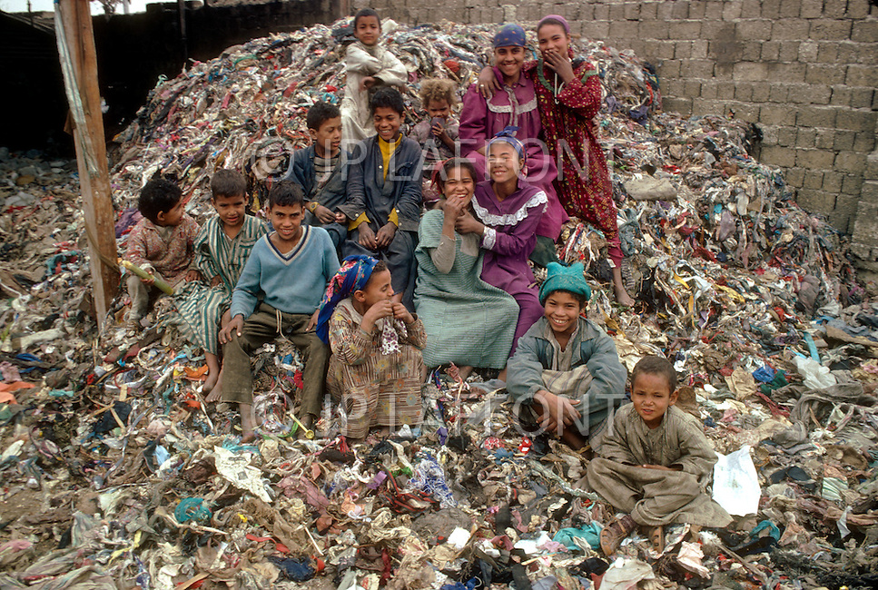 In Egypt, young girls are employed as rag pickers. - Child labor as seen around the world between 1979 and 1980 - Photographer Jean Pierre Laffont, touched by the suffering of child workers, chronicled their plight in 12 countries over the course of one year.  Laffont was awarded The World Press Award and Madeline Ross Award among many others for his work.