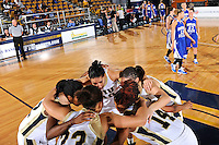 28 November 2010:  FIU's team gathers at mid-court prior to the start of the game.  The FIU Golden Panthers defeated the Indiana State Sycamores, 68-47, to win the 16th annual FIU Thanksgiving Classic at the U.S. Century Bank Arena in Miami, Florida.
