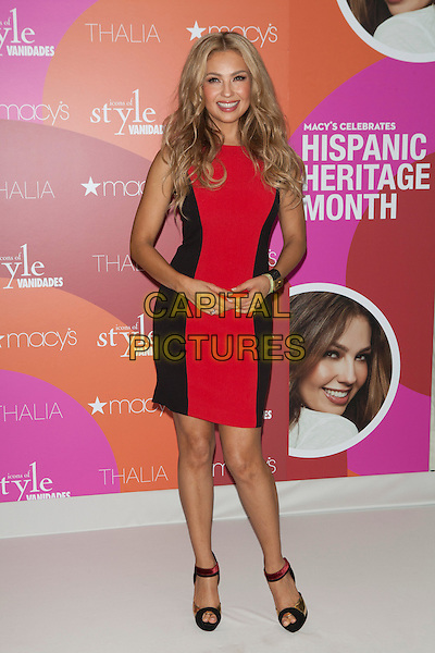 Thalia (Ariadna Thalia Sodi Miranda)<br /> Macy's and Vanidades honor 2013 Icon of Style, Thalia, during Hispanic Heritage month at Herald Square, New York City, NY, USA.<br /> September 26th, 2013<br /> full length black red dress <br /> CAP/MPC/COR<br /> &copy;Corredor99/ MediaPunch/Capital Pictures