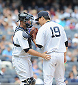 Masahiro Tanaka, Brian McCann (Yankees),<br /> JUNE 5, 2014 - MLB :<br /> Pitcher Masahiro Tanaka of the New York Yankees talks with catcher Brian McCann during the Major League Baseball game against the Oakland Athletics at Yankee Stadium in Bronx, New York, United States. (Photo by AFLO)