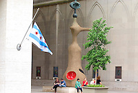 Jean Miro Sculpture of a woman at the Chicago Jewish Temple and Chicago flag.  Chicago Illinois USA
