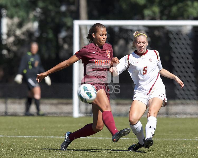 Boston College midfielder Lauren Bernard (5) passes the ball as Virginia Tech forward Jazmine Reeves (5) closes.Virginia Tech (maroon) defeated Boston College (white), 1-0, at Newton Soccer Field, on September 22, 2013.