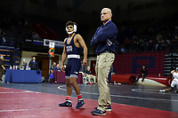 PHILADELPHIA, PA - NOVEMBER 18: Roman Bravo-Young of the Penn State Nittany Lions stands with head coach Cael Sanderson during a time-out in the 133 pound championship match at the Keystone Classic on November 18, 2018 at The Palestra on the campus of the University of Pennsylvania in Philadelphia, Pennsylvania. (Photo by Hunter Martin/Getty Images) *** Local Caption *** Roman Bravo-Young;Cael Sanderson