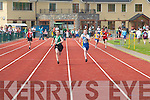 Ian Sayers (Spa/Fenit) leads Kevin OSullivan (Spa/Muckross) down the back straight during the Boys 4x100m relay at the Community Games County finals in An Riocht Track, Castleisland, on Sunday..