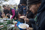 A refugee eating food made and served by the We Picknick group in a park in Berlin. The volunteer initiative was one of many initiated by citizens of the city to help refugees. Around 60,000 refugees arrived in the city in the first 10 months of 2015, out of an overall total of around 850,000 in the whole of Germany.