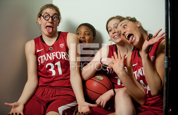 DENVER, CO--Toni Kokenis, Joslyn Tinkle, Amber Orrange, and Lindy LaRocque have fun with the cameras during media day at the Pepsi Center for the 2012 NCAA Women's Final Four in Denver, CO.