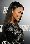 "HOLLYWOOD, CA. - April 30: Zoe Saldana arrives at the Los Angeles premiere of ""Star Trek"" at the Grauman's Chinese Theater on April 30, 2009 in Hollywood, California.a"