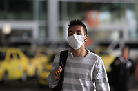 "BOGOTA, COLOMBIA - March 12:  A man wears a face mask as he walks around the International airport ""El Dorado"" on March 12, 2020 in Bogota, Colombia. The World Health Organization declared a global pandemic as the coronavirus rapidly spreads across the world. Colombian President Ivan Duque declared a health emergency to contain an outbreak of coronavirus, suspending public events with more than 500 people. (Photo by Daniel Munoz/VIEWpress)"