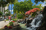 Flowers and waterfall fountain at Kuhio Beach Park, Waikiki Beach, Honolulu, Oahu, Hawaii