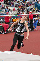 Summit Christian Academy sophomore Carlie Queen makes her way to the bar in the high jump and went on to win the event, clearing 5-8, at the 2015 Kansas Relays.