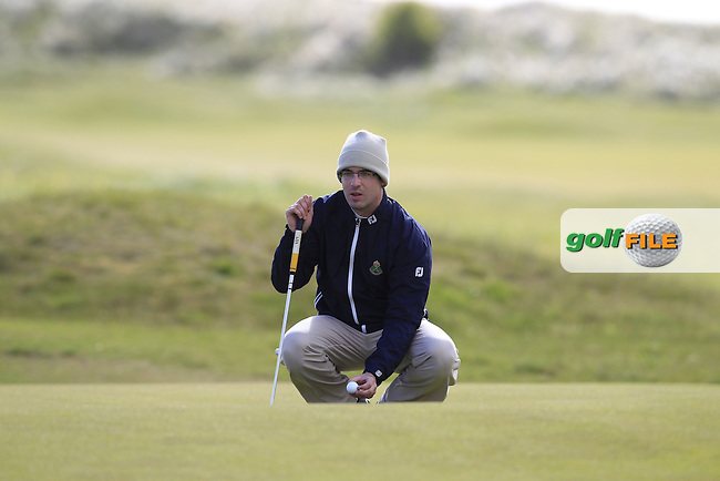 Gary McGrane (IRL) lines up his putt on the 10th green during Saturday's Round 2 of the 2013 Irish Amateur Open Championship at The Royal Dublin Golf Club, 11th May 2013..Picture: Eoin Clarke www.golffile.ie.
