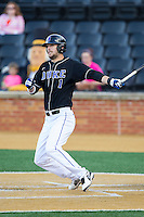 Ryan Deitrich (1) of the Duke Blue Devils follows through on his swing against the Wake Forest Demon Deacons at Wake Forest Baseball Park on April 25, 2014 in Winston-Salem, North Carolina.  The Blue Devils defeated the Demon Deacons 5-2.  (Brian Westerholt/Four Seam Images)