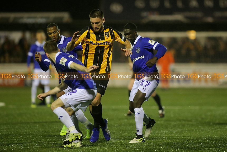 Jake Cassidy of Maidstone tries to burst through the Oldham defence during Maidstone United vs Oldham Athletic, Emirates FA Cup Football at the Gallagher Stadium on 1st December 2018