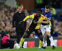 29th October 2019; Goodison Park, Liverpool, Merseyside, England; English Football League Cup, Carabao Cup Football, Everton versus Watford; Domingos Quina of Watford and Seamus Coleman of Everton compete for the ball watched by Everton Manager Marco Silva - Strictly Editorial Use Only. No use with unauthorized audio, video, data, fixture lists, club/league logos or 'live' services. Online in-match use limited to 120 images, no video emulation. No use in betting, games or single club/league/player publications