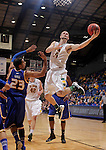 SIOUX FALLS, SD - MARCH 10:  Taylor Braun #24 of NDSU sails past Trinity Hall #23 of UMKC during their quarterfinal game at the 2013 Summit League Basketball Championships. (Photo by Dick Carlson/Inertia)